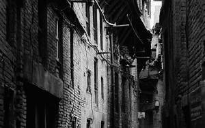 Dim Alley Falnked By Old Buildings