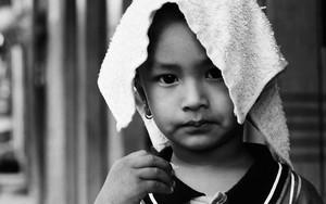 タオルの載せた少年