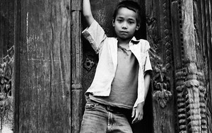 Boy In Front Of The Wooden Door