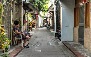 Older Woman Relaxing In The Lane