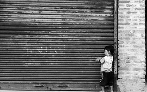 Lonley Boy In Front Of The Shutter
