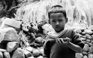 Boy Holding A Vessel
