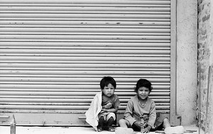 Kids In Front Of The Shutter