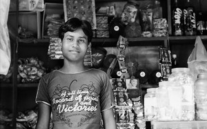 Shopkeeper Wearing A T-shirt