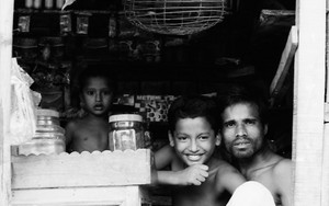 Father And His Sons In A Small Shop