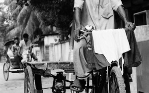 Man Riding The Tricycle