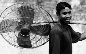 Man Carryig A Big Fan