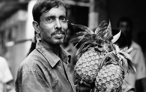 Pineapples In His Hands