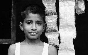 Boy Wearing A Tank Top And Snacks