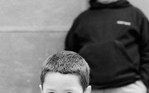 Bashful Boy Wearing A Parka