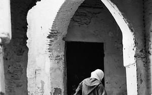Woman Wearing A Jellaba In The Lane