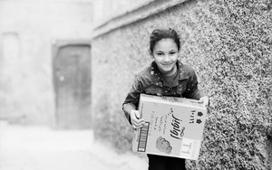 Girl Carrying A Box