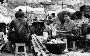 Woman Sitting Among The Food Stalls