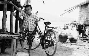 Boy In Front Of A Bicycle