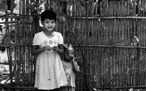 Girl Wearing A Dress And Her Little Brother Holding A Toy Rifle