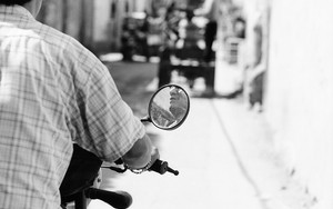 Chin In The Mirror Of The Motorbike