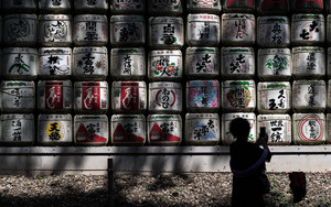 Silhouette In Front Of Sake Barrels