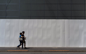 Couple In Front Of White Fence