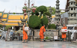 Monks Carrying