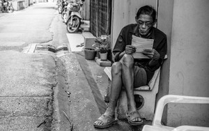 Man Reading A Paper