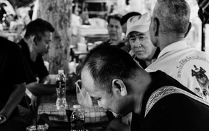 Men Enjoying Playing Thai Chess