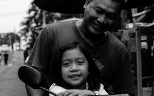 Father And His Daughter Smiling On Motorbike