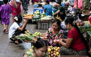 Women Sitting On Side Of Street Market