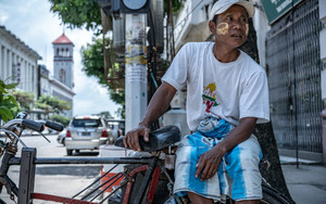Rickshaw Man In A Street Corner