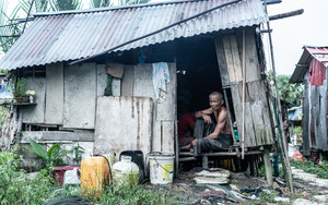 Man In Shanty House
