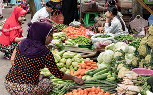 Woman Buying In Greengrocery