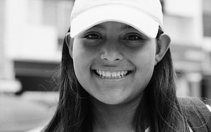 Smile Of A Girl Wearing A Cap