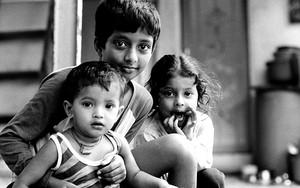 Three Kids Sitting Together