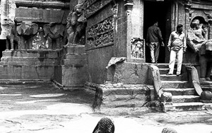 Two Women In Front Of A Temple