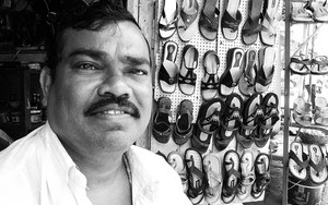 Man Working In A Shoe Shop
