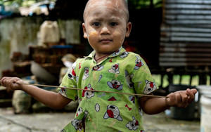 Little Boy Having A Thin Rod