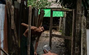 Men Repairing The Gate
