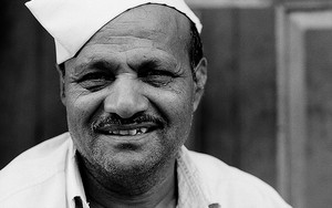 Man Wearing A Gandhi Cap