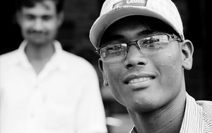 Young Man Wearing Glasses And A Cap