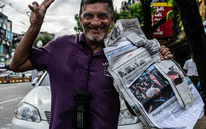 Newspapers And Peace Sign