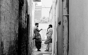 Two Men Discussing In The Back Street