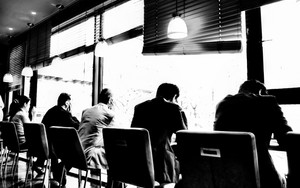 Businessmen In A Cafe