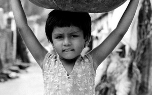 Girl Carrying A Bowl