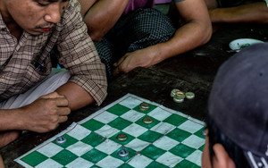Men Around Checkered Board