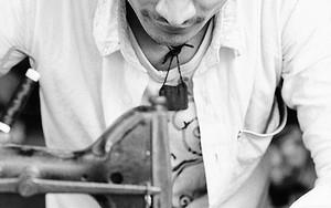 Young Man Sews