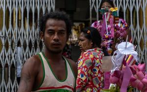 Man Selling Offerings In Shwemawdaw Pagoda