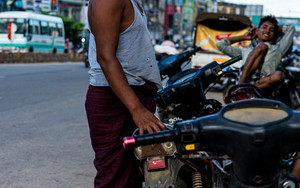 Man Standing Beside Motorbike