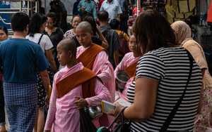 Buddhist Nuns In The Crowd