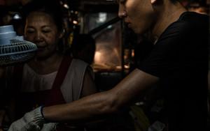Young Man Making Sponge Cake In Linjiang Night Market