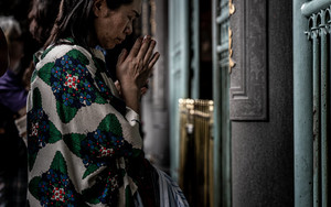 Woman Praying Seriously