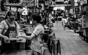 Mother And Daughter In Deserted Night Market